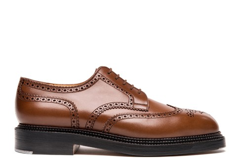 Medallion wing-tip Derby, triple sole.